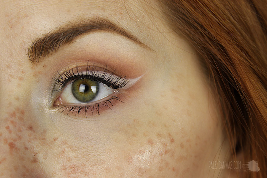 Freckles and white eyeliner